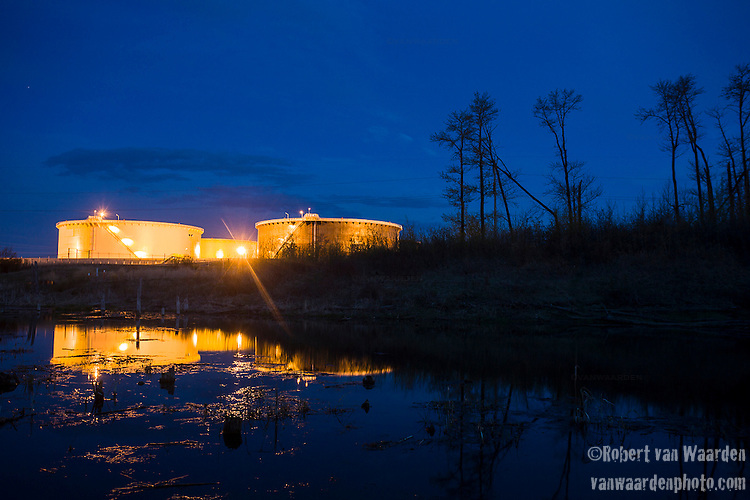 The Hardisty Tank terminal seen at night. Hardisty is the proposed start of the the Energy East pipeline, the Keystone XL pipeline and the the majority of the oil that comes from the Tar Sands in Alberta passes through Hardisty.  (Credit: Robert van Waarden - http://alongthepipeline.com)