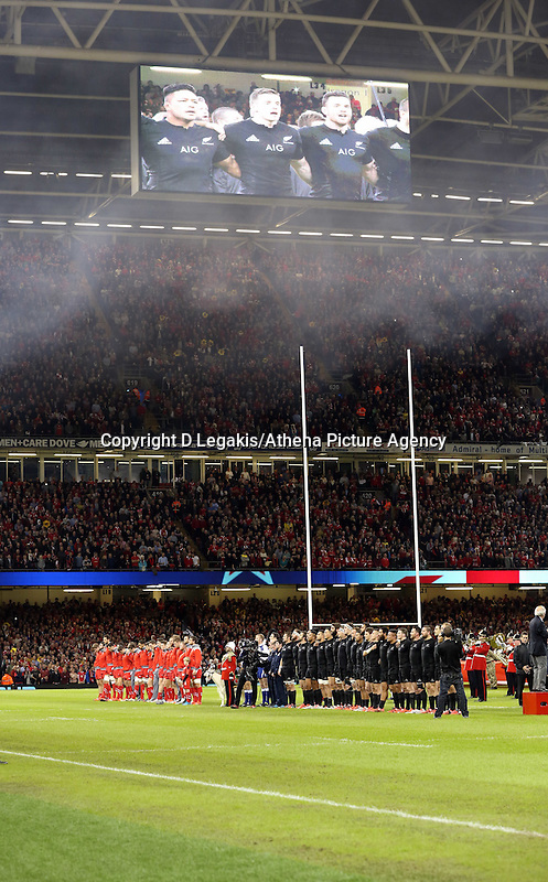 Pictured: Wales (L) and New Zealand (R) players line up for their national anthems Saturday 22 November 2014<br /> Re: Dove Men Series 2014 rugby, Wales v New Zealand at the Millennium Stadium, Cardiff, south Wales, UK.