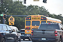 PEMBROKE PINES, FLORIDA - AUGUST 18: Broward County School Buses seen on the road for the first day of classes at Broward County Public school in Pembroke Pines, Florida, U.S., on Wednesday, Aug. 18, 2021.  Florida State Board of Education said it would force defiant school districts to comply with Republican Governor Ron DeSantis executive order forbidding them from mandating students wear masks as a way to slow a surge in Covid-19 cases.  ( Photo by Johnny Louis / jlnphotography.com )