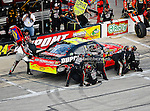 Jeff Gordon, driver of the (24) DuPont Chevrolet, makes a pit stop during the Samsung Mobile 500 Sprint Cup race at Texas Motor Speedway in Fort Worth,Texas.