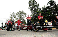 Aug. 5, 2011; Kent, WA, USA; Crew members for NHRA top fuel dragster driver Larry Dixon during qualifying for the Northwest Nationals at Pacific Raceways. Mandatory Credit: Mark J. Rebilas-