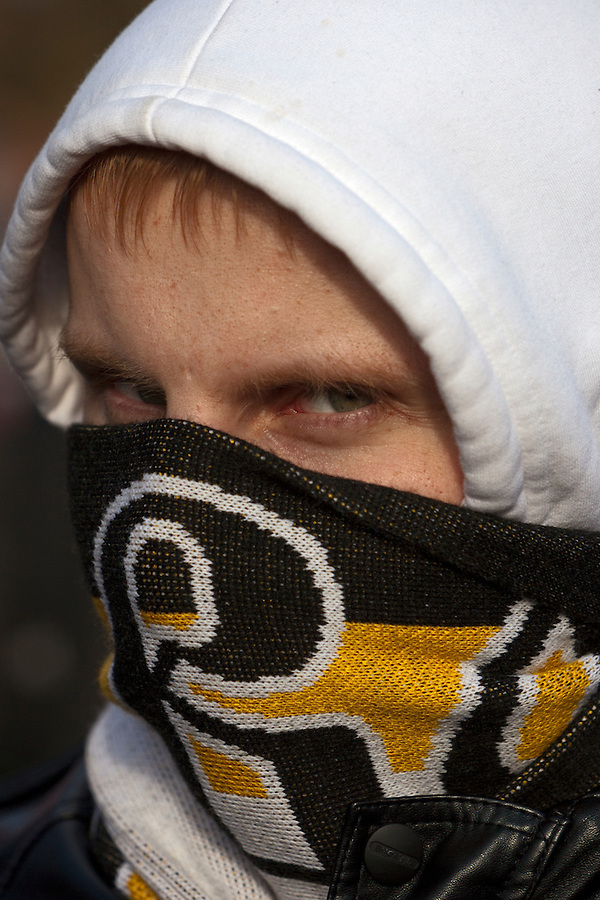"""Moscow, Russia, 22/10/2011..A demonstrator with his face wrapped in a Russian nationalist scarf at a  protest """"""""Stop Feeding The Caucasus"""" against the alleged over-subsidisation of the North Caucasus region, including Chechnya, by the central Russian government. The campaign has been organised by the Russian Public Movement and the Russian Civil Union, who have joined under the common banner of The Russian Platform."""