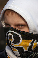 "Moscow, Russia, 22/10/2011..A demonstrator with his face wrapped in a Russian nationalist scarf at a  protest """"Stop Feeding The Caucasus"" against the alleged over-subsidisation of the North Caucasus region, including Chechnya, by the central Russian government. The campaign has been organised by the Russian Public Movement and the Russian Civil Union, who have joined under the common banner of The Russian Platform."