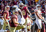 Florida State and Northern Illinois players watch a 50 yard field goal attempt by Ricky Aguayo sail through the uprights to end the first half on September 22, 2018 in Tallahassee, Florida.  The Seminoles defeated the Huskies 37-19.