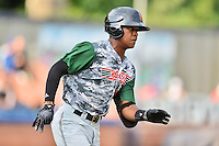 Augusta GreenJackets second baseman Jalen Miller (5) runs to first base during a game against the Asheville Tourists at McCormick Field on July 21, 2016 in Asheville, North Carolina. The GreenJackets defeated the Tourists 6-3. (Tony Farlow/Four Seam Images)