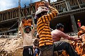 Bangladeshi migrant workers work in construction sites in Thimphu, Bhutan. Photo: Sanjit Das/Panos