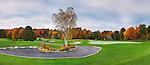 Golf course and colorful autumn trees, beautiful panoramic fall nature scenery at dawn. Muskoka, Ontario, Canada.