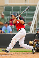 Kevan Smith #32 of the Kannapolis Intimidators follows through on his swing against the Lexington Legends at CMC-Northeast Stadium on May 20, 2012 in Kannapolis, North Carolina.  The Legends defeated the Intimidators 7-1.  (Brian Westerholt/Four Seam Images)