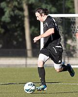 Brown University midfielder Thomas McNamara (7) brings the ball forward. Brown University (black) defeated Boston College (white), 1-0, at Newton Campus Field, October 16, 2012.