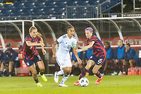 EAST HARTFORD, CT - JULY 1: Stephany Mayor #10 of Mexico is marked by Lindsey Horan #9 of the United States and Megan Rapinoe #15 during a game between Mexico and USWNT at Rentschler Field on July 1, 2021 in East Hartford, Connecticut.