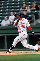 Center fielder Joseph Monge (15) of the Greenville Drive bats in a game against the Lexington Legends on Tuesday, April 14, 2015, at Fluor Field at the West End in Greenville, South Carolina. Lexington won, 5-3. (Tom Priddy/Four Seam Images)