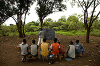 A secondary school class  for refugee children held under  a tree in Makpandu South Sudan.