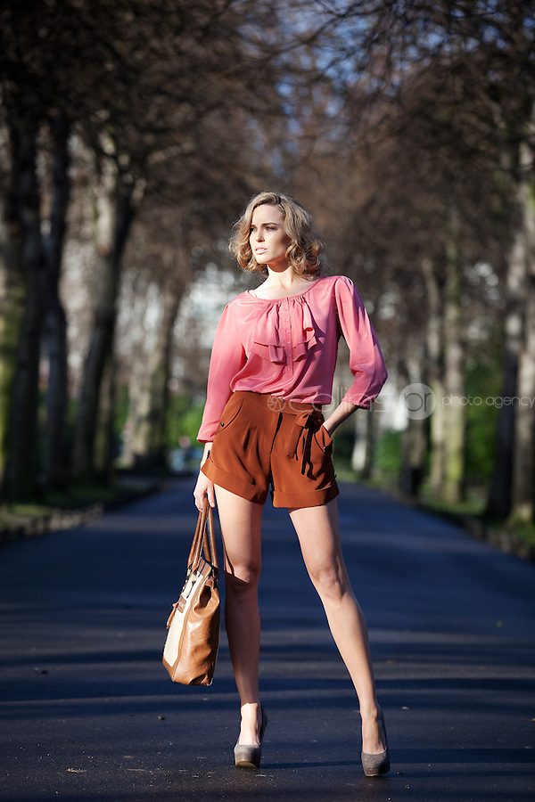 NO REPRO FEE. 1/2/2011. A|WEAR LAUNCHES SPRING 2011.  Sarah Morrissey and Isabelle Traber model a selection looks from A|wear's spring '11 collection at  St Stephens Green, Dublin. Sarah wears Ivy scoop neck ruffle blouse - EUR30,Copper pocket detail shorts - EUR30, Straw mix shopper - EUR35. The collection is available now instore and on www.awear.com from this week. Picture James Horan/Collins Photos