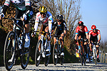 The peloton including Olympic Champion Greg Van Avermaet (BEL) AG2R Citroen Team and Tiesj Benoot (BEL) Team DSM gives chase on Oude Kwaremtont during the 73rd edition of Kuurne-Brussel-Kuurne 2021 running 197km from Kuurne to Kuurne, Belgium. 28th February 2021  <br /> Picture: Serge Waldbillig | Cyclefile<br /> <br /> All photos usage must carry mandatory copyright credit (© Cyclefile | Serge Waldbillig)