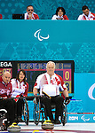 Sochi, RUSSIA - Mar 13 2014 - Ina Forrest and Jim Armstrong as Canada takes on Slovakia in round robin play at the 2014 Paralympic Winter Games in Sochi, Russia.  (Photo: Matthew Murnaghan/Canadian Paralympic Committee)