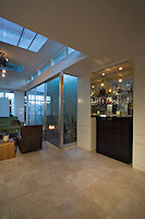 Built-in bar in 60's Palm Springs home shown at night