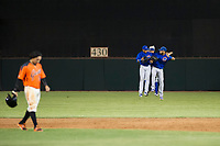 AZL Cubs outfielders Nelson Velazquez (20), Jose Gutierrez (91), and Jonathan Sierra (22) celebrate after winning a game against the AZL Giants on September 5, 2017 at Scottsdale Stadium in Scottsdale, Arizona. AZL Cubs defeated the AZL Giants 10-4 to take a 1-0 lead in the Arizona League Championship Series. (Zachary Lucy/Four Seam Images)