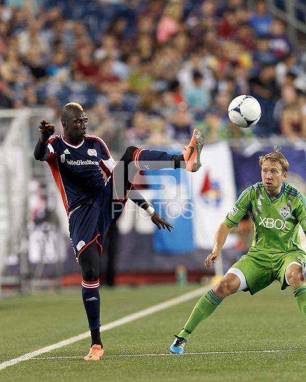 New England Revolution midfielder Saer Sene (39) redirects a pass. In a Major League Soccer (MLS) match, the New England Revolution tied the Seattle Sounders FC, 2-2, at Gillette Stadium on June 30, 2012.
