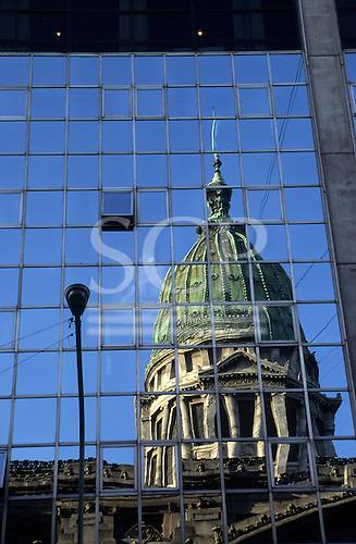 Buenos Aires, Argentina. The Congress building reflected in a mirrored modern building.