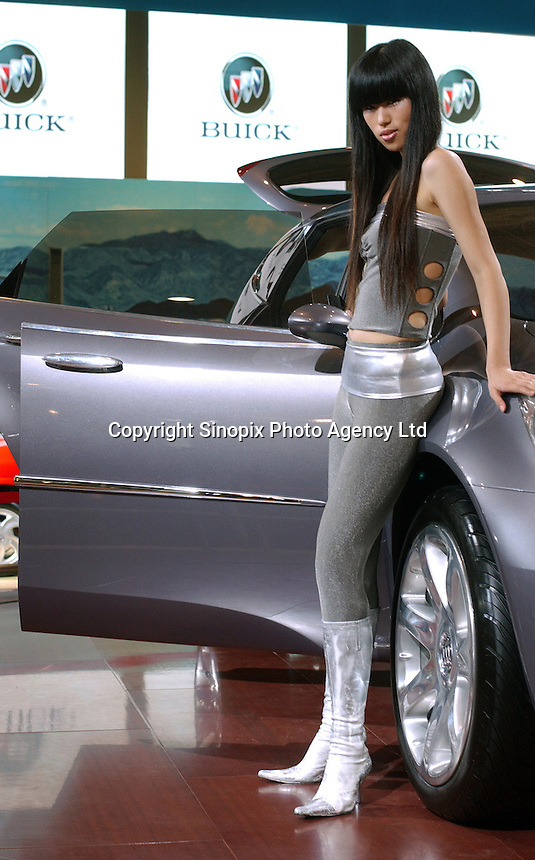 A model displays a Buick at the Auto China 2004 exhibition in Beijing, China..