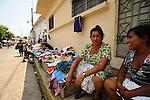 A street vendor sells second hand clothes in the peaceful, hilltop town of Suchitoto, El Salvador..