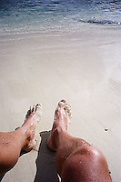 Tanned legs and sandy toes<br />