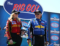 Sep 3, 2017; Clermont, IN, USA; NHRA funny car driver Courtney Force (left) alongside father John Force during qualifying for the US Nationals at Lucas Oil Raceway. Mandatory Credit: Mark J. Rebilas-USA TODAY Sports