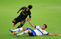 LOS ANGELES, CA - SEPTEMBER 02: Cade Cowell #44 of the San Jose Earthquakes slide tackles Latif Blessing #7 of LAFC during a game between San Jose Earthquakes and Los Angeles FC at Banc of California stadium on September 02, 2020 in Los Angeles, California.