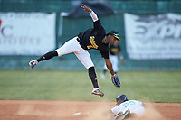 RJ Connor (16) (Queens University) of the Statesville Owls jumps for a high throw as Houston Koon (22) (Campbell) of the Mooresville Spinners slides head-first into second base at Moor Park on June 14, 2020 in Mooresville, NC.  The Owls defeated the Spinners 8-7 in 10 innings. (Brian Westerholt/Four Seam Images)