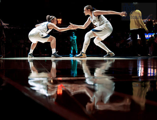 Feb 11, 2013; Natalie Achonwa (11) and Kayla McBride (21) greet each other during the player intro before the game against the Louisville Cardinals at the Purcell Pavilion. <br /> <br /> Photo by Matt Cashore