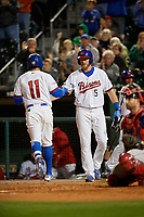 Buffalo Bisons left fielder Michael Saunders (5) congratulates Christian Lopes (11) after hitting a home run during a game against the Pawtucket Red Sox on August 31, 2017 at Coca-Cola Field in Buffalo, New York.  Buffalo defeated Pawtucket 4-2.  (Mike Janes/Four Seam Images)