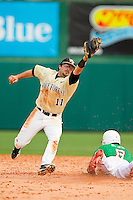 Wake Forest Demon Deacons shortstop Pat Blair #11 reaches for a high throw as Trea Turner #8 of the North Carolina State Wolfpack steals second base at Doak Field at Dail Park on March 17, 2012 in Raleigh, North Carolina.  The Wolfpack defeated the Demon Deacons 6-2.  (Brian Westerholt/Four Seam Images)