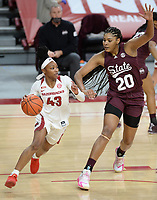 Arkansas guard Makayla Daniels (43) drives Thursday, Feb. 11, 2021, around Mississippi State center Yemiyah Morris (20) during the first half of play in Bud Walton Arena. Visit nwaonline.com/210212Daily/ for today's photo gallery. <br /> (NWA Democrat-Gazette/Andy Shupe)