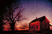 House in the country by tree at sunset.