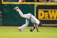 Detroit Tigers outfielder Torii Hunter (48) tumbles after making a running catch during the MLB baseball game against the Houston Astros on May 3, 2013 at Minute Maid Park in Houston, Texas. Detroit defeated Houston 4-3. (Andrew Woolley/Four Seam Images).