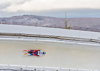9 January 2016: Sergei Chudinov, competing for Russia, slides through Curve 14 on his second run of the day during the BMW IBSF World Cup Skeleton Championships at the Olympic Sports Track in Lake Placid, New York, USA. Chudinov ended the day with a combined 2-run time of 1:51.20 and a 16th place overall finish. Mandatory Credit: Ed Wolfstein Photo *** RAW (NEF) Image File Available ***