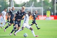 LAKE BUENA VISTA, FL - JULY 9: Keaton Parks #55 of NYCFC, Jamiro Monteiro #10 of the Philadelphia Union battle for the ball during a game between New York City FC and Philadelphia Union at Wide World of Sports on July 9, 2020 in Lake Buena Vista, Florida.