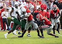 ATHENS, GA - SEPTEMBER 11: DeWayne McBride #22 is tackled by Quay Walker #7 during a game between University of Alabama Birmingham Blazers and University of Georgia Bulldogs at Sanford Stadium on September 11, 2021 in Athens, Georgia.