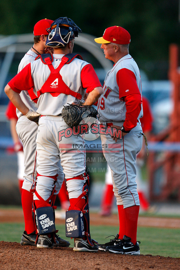 August 5, 2009:  Pitching Coach Rick Tomlin of the Brooklyn Cyclones talks with Catcher Dock Doyle and Pitcher Darin Gorski during a game at Dwyer Stadium in Batavia, NY.  The Cyclones are the Short-Season Class-A affiliate of the New York Mets.  Photo By Mike Janes/Four Seam Images