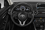Car pictures of steering wheel view of a 2018 Toyota Yaris-iA AT 4 Door Sedan Steering Wheel