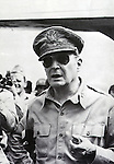 Undated - Douglas MacArthur (1880-1964) wearing his trademark sunglasses and a pipe. He was ordered on August 29, 1945 to exercise authority through the Japanese government machinery, including Emperor Hirohito. MacArthur as Supreme Commander of the Allied Powers in Japan and his GHQ staff helped a devastated Japan rebuild itself, institute a democratic government, and chart a course that made Japan one of the world's leading industrial powers.  (Photo by Kingendai Photo Library/AFLO)