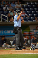 Umpire Brock Ballou calls a strike during a Southern League game between the Mobile BayBears and Pensacola Blue Wahoos on July 25, 2019 at Blue Wahoos Stadium in Pensacola, Florida.  Pensacola defeated Mobile 3-2 in the second game of a doubleheader.  (Mike Janes/Four Seam Images)