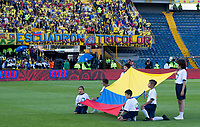 BOGOTA - COLOMBIA, 03-06-2019: Un grupo de niños sostienen la bandera de Colombia previo al partido amistoso entre Colombia y Panamá jugado en el estadio El Campín en Bogotá, Colombia. / A group of Children hang a Colombian flag prior a friendly match between Colombia and Panama played at Estadio El Campin in Bogota, Colombia. Photo: VizzorImage/ Gabriel Aponte / Staff