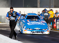Feb 12, 2017; Pomona, CA, USA; A crew member for NHRA funny car driver John Force during the Winternationals at Auto Club Raceway at Pomona. Mandatory Credit: Mark J. Rebilas-USA TODAY Sports