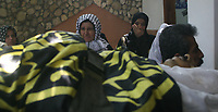 "Palestinian women look on as mourners pass by carrying the body of 25-year-old Hisham al-Jamal during his funeral at Rafah refugee camp in the Gaza Strip, 05 August 2007. Two Palestinian militants from the Islamic Jihad group were killed yesterday and others wounded in an Israeli air strike targeting a car in the south of the Gaza Strip, medical sources said.""photo by7 Fady Adwan"""