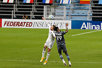 ST PAUL, MN - NOVEMBER 4: Djordje Mihailovic #14 of Chicago Fire FC and Romain Metanire #19 of Minnesota United FC battle for the header during a game between Chicago Fire and Minnesota United FC at Allianz Field on November 4, 2020 in St Paul, Minnesota.