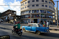 ETHIOPIA , Harar street traffic and modern building, old peugeot cab / AETHIOPIEN, Harar, Verkehr und moderne Haeuser, altes Peugeot Taxi