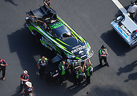 Apr. 28, 2012; Baytown, TX, USA: Aerial view of NHRA crew members for funny car driver Alexis DeJoria during qualifying for the Spring Nationals at Royal Purple Raceway. Mandatory Credit: Mark J. Rebilas-