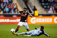 Claudio Bieler (16) of Sporting Kansas City goes in on a tackle on Amobi Okugo (14) of the Philadelphia Union during the second half. Sporting Kansas City defeated the Philadelphia Union 3-1 during a Major League Soccer (MLS) match at PPL Park in Chester, PA, on March 2, 2013.