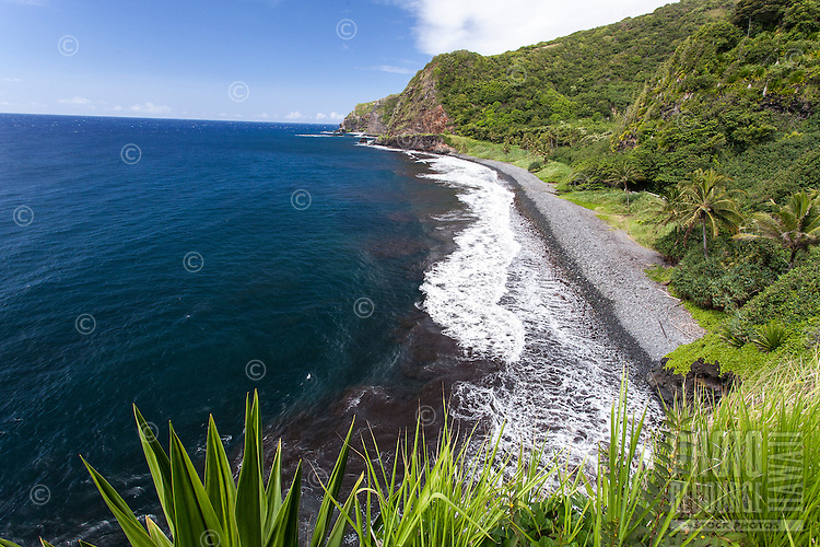 A pebble beach shoreline along the Hana Hwy. on the Kipahulu coast of south Maui